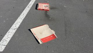 Pizza boxes thrown out onto one of the foreshore carparks. Photo: Hele Ikimotu