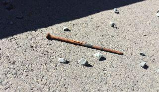 Rusted nail found under the boardwalk. Photo: Hele Ikimotu